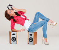 Studio shot of young woman listening the music Royalty Free Stock Image
