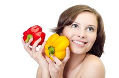 Studio shot of a young woman with two peppers Stock Photos