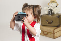 Studio slaes girl. Young girl plays dressup in the studio Royalty Free Stock Photography