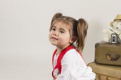 Studio slaes girl. Young girl plays dressup in the studio Royalty Free Stock Images