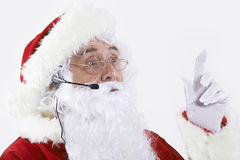 Studio som skjutas av Santa Claus Wearing Headset arkivbild