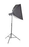 Studio strobe, isolated on a white background. Proffesional photo studio equipment. Studio flash with soft-box. Stock Photo