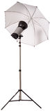 Studio strobe light flash with umbrella royalty free stock images