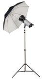 Studio strobe light flash with umbrella stock photography