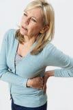 Studio strzał Dojrzały kobiety cierpienie Z cynaderki bólem zdjęcie royalty free