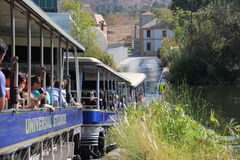 Studio Tour at Universal Studios Hollywood. Los Angeles, California, USA - October 10, 2014: StudioTour Tram is going through the lake during the studio tour at Stock Photography