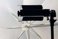 Studio umbrella and light Royalty Free Stock Photos