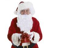 Studio van Santa Claus Holding Gift Wrapped Present wordt geschoten die stock fotografie