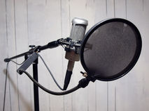 Studio vocal microphone & grunge wall 2 Royalty Free Stock Image