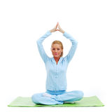 Studio yoga woman Stock Photography