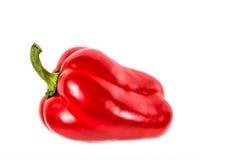 Studiobeeld van één enkele rode groene paprika Stock Afbeelding