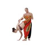 Studiobild av den benägna kvinnan för yogainstruktörutbildning Arkivfoton