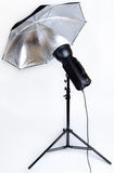 Studioflash with silver umbrella Stock Images