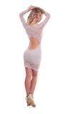 Studiofoto av en härlig flicka på en vit bakgrund arkivfoto