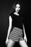 Studiofoto der jungen Frau auf schwarzem Hintergrund Rebecca 6 Lizenzfreies Stockbild
