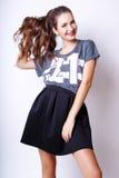 Studiofoto der jungen Frau auf weißem Hintergrund Lizenzfreies Stockfoto