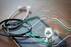 Studiomakroen av en stetoskop och den digitala minnestavlan med grunt GÖR Fotografering för Bildbyråer