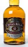 Studioskott av en flaska av Chivas Regal på vit bakgrund Royaltyfri Fotografi
