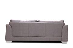 Studioskott för bakre sikt av en modern grå soffa arkivfoton