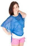 Studiostående av en attraktiv ung kvinna över vitbakgrund Royaltyfria Foton