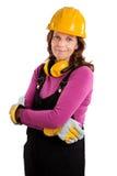 Studiostående av en kvinnlig byggnadsarbetare som isoleras på vit Arkivbild
