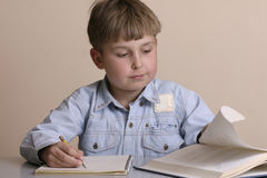 Studious boy. Boy with textbook royalty free stock images