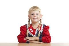 Studious girl. Studious small girl in studio Stock Photo