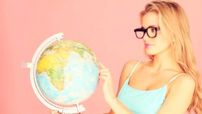 Studious Woman With Globe stock video footage