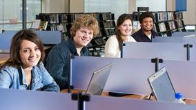 Studiying in cubicoli Fotografia Stock