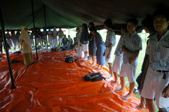 Studiying in makeshift tent. Junior high school students studying in makeshift tent when an earthquake in Klaten, Central Java, Indonesia Stock Photo