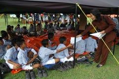 Studiying in makeshift tent. Junior high school students studying in makeshift tent when an earthquake in Klaten, Central Java, Indonesia Stock Image