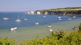 Studland bay with mooring boats and Old Harry Rocks in the background near Swanage Royalty Free Stock Photography