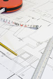 Study. Engineer, architect or contractor plans and tools laid out on a table Stock Photos