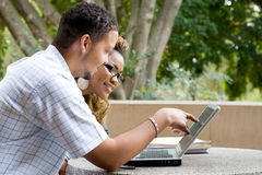 Study. Two african college students study computer laptop together outdoors Royalty Free Stock Photography