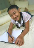 Study. Close-up girl in the bedroom royalty free stock photography