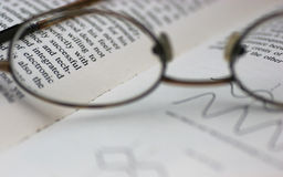 Study. Glasses on a technical book. Focus of the word successful Stock Images