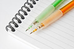 Study. 2 colourful mechanical pencils on top of a notebook stock photo