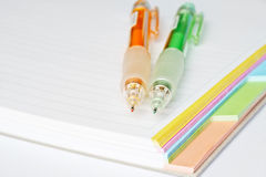 Study. 2 colourful mechanical pencils on top of a notebook royalty free stock photos