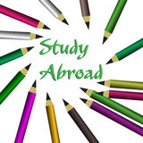 Study abroad. Abstract colorful background with colored pencils and the text study abroad written with green letters in the middle of the image Royalty Free Stock Photos
