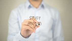 Study Abroad, Man Writing on Transparent Screen stock images