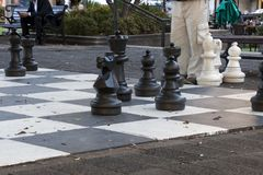 Playing giant chess in Hyde Park on an autumn afternoon royalty free stock images