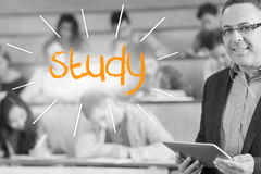 Study against lecturer standing in front of his class in lecture hall Royalty Free Stock Image