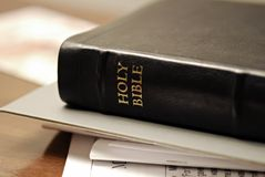 Study Bible. Holy Bible on top of stack of papers Stock Photos