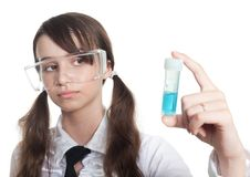 Study biology. Clever teenage girl study biology looking at test tube Stock Photography