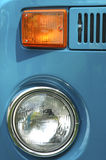 Study in Blue, Orange, Chrome & Glass. Headlamp, directional, and part of grille on VW Microbus stock photos