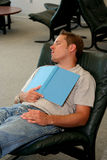 Study Break. Student sleeping with book over chest Royalty Free Stock Photography