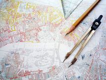 Study of city planning map. A conceptual image of the study of an old city planning map. Taken with compass divider, pencil and set square. Horizontal color Royalty Free Stock Image