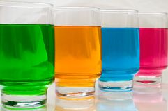 Study of colours. Glasses with colours liquid royalty free stock image