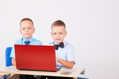Study on the computer two boys at school. 1 Stock Photos
