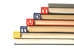 Study Concept. Alphabet blocks spell out the word study on a pile of books Royalty Free Stock Photos